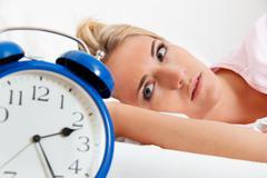 clock with sleep at night. - stock photo