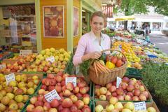 women in the vegetable market - stock photo