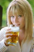 Woman with beer glass in the garden Stock Photos