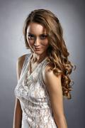 Fascinating young model posing in sexy negligee - stock photo