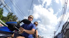 Happy Young Love Couple on Scooter Enjoying Trip at Summer Time Stock Footage