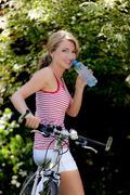 Woman with mountain bike Stock Photos