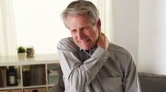 Elderly man with neck pain - stock footage