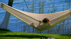 Leisure hammock lounging aside a Bacalar, Mexico lagoon Stock Footage