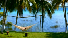 Leisure hammock lounging aside a Bacalar, Mexico lagoon 2 Stock Footage