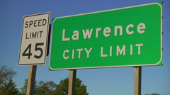 Close Up of Lawrence, KS Sign with Speed Limit Sign Stock Footage