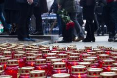 Mourning candles on the street near the funeral of Boris Nemtsov - stock photo