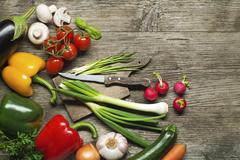Vegetables collection on wooden background - stock photo