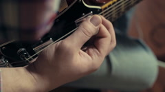 man playing electric guitar slow motion closeup - stock footage