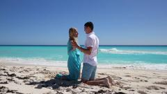 Young couple holding hands on  beach Stock Footage