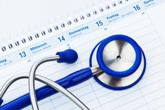 Stethoscope and calendar. doctor's appointment Stock Photos