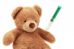 Teddy bear with injection Stock Photos