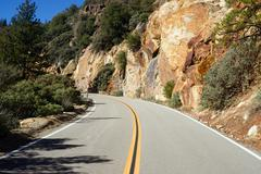 Two Lane Road Through Granite Rock King's Canyon California - stock photo