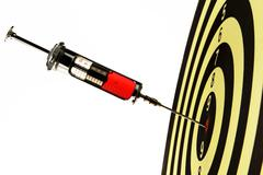 syringe injection into a target - stock photo