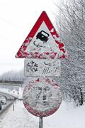 snowy road signs - stock photo