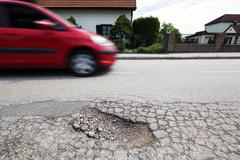 Road with potholes. frost heave Stock Photos