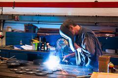 welders in the workshop in the metal industry - stock photo