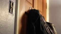 Light switch to hanging sweater focus Stock Footage