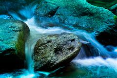 Stream in the mountains with water and stones Stock Photos