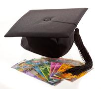 mortarboard and swiss francs. education costs. - stock photo