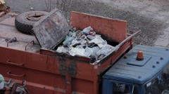 Ungraded: Garbage Truck Sweeps Contents of Waste Container Into Hopper Stock Footage
