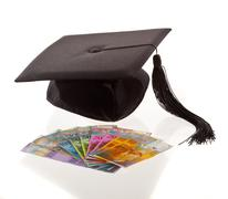 Mortarboard and swiss francs. Stock Photos