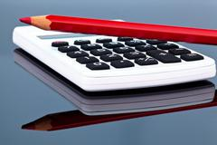 red pencil and calculator - stock photo