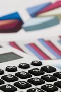 calculators and graphics of a balance - stock photo