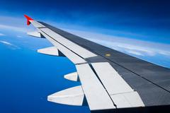 wing of a passenger aircraft - stock photo