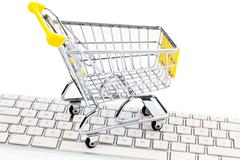 Cart and keyboard. online shopping Stock Photos