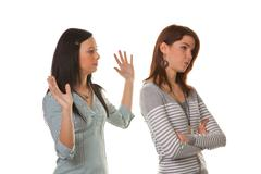 women are angry and offended when arguing - stock photo