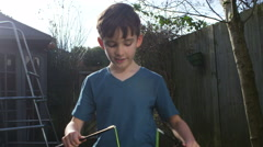 A young boy plays with diabolo. Shot on RED Epic in slow motion. Stock Footage