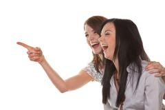 Stock Photo of two young women burst into laughter