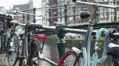 Bikes and canal an urbanscape in Amsterdam, the Netherlands - stock footage
