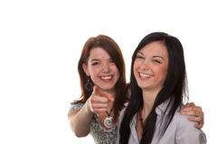 Two young women burst into laughter Stock Photos