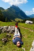 Hikers relax at hike in the mountains Stock Photos
