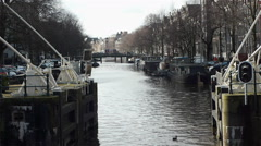 Sluice and canal. Haarlemmersluis in Amsterdam, the Netherlands - stock footage