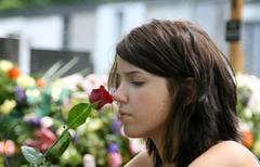 Woman at the cemetery in a grave Stock Photos