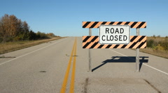 Road closed sign with road. Stock Footage