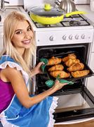 Woman bake cookies Stock Photos