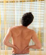 pain in the back. - stock photo