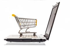 shopping carts and computer keyboard - stock photo