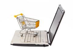 Shopping carts and computer keyboard Stock Photos