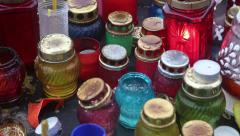 Candles inside glass many-coloured lamps Stock Footage
