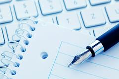 Note pad and keyboard of a computer Stock Photos