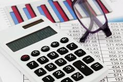 calculator and figures - stock photo