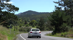 Cars, traffic on countryside road, Coromandel Peninsular, New Zealand Stock Footage