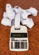 Desktop calculator with tape for computing costs, expenses, reve Stock Photos