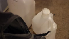 Water bottles next to backpack Stock Footage