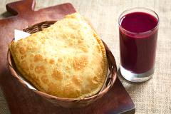 Pastel, a Bolivian Snack with Api, a Purple Corn Beverage Stock Photos
